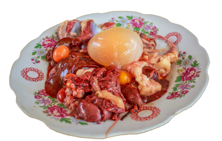 offal: Fresh raw chicken liver  and egg on the plate against a white background Stock Photo