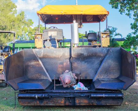 blacktopping: asphalt cars  for road repairing Stock Photo