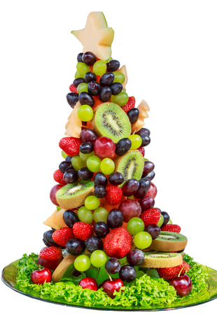 christmas ground: christmas tree made from fruit Berry on white back ground