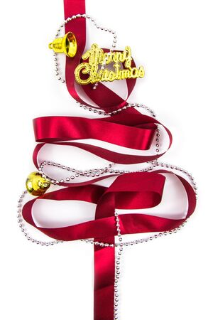 christmas tree made from ribbons winter decorations on white background with empty copy space for text. holiday and celebration creative concept. top view Stock Photo
