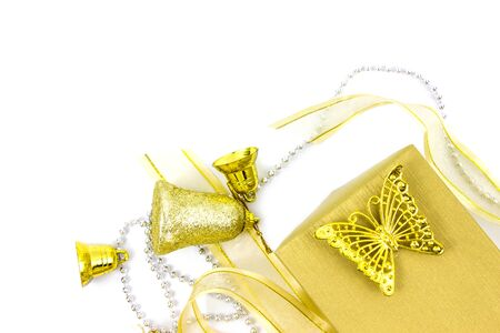 Christmas golden and silver decorations isolated on white background. Gold color gift box
