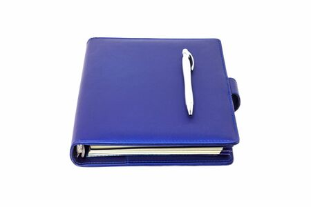 Blue collar diary and pen placed on cover and white background. Stockfoto