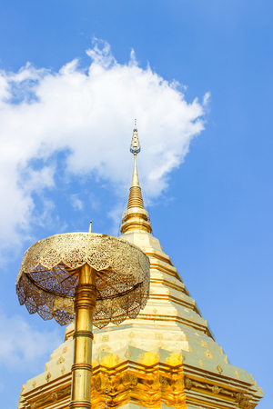Golden pagoda and umbrella in Wat Phra That Doi Suthep is the popular tourist destination of Chiang Mai, Thailand.