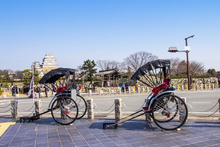 HIMEJI, JAPAN - MARCH 11, 2018: Rickshaw waiting for tourist service around himeji castle on day blue sky bright hyogo prefecture. Japan Editorial