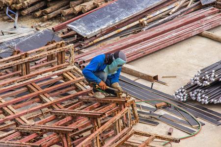 Industrial welding worker for steel work construction in area building with Welding process by Shielded Metal Arc Welding. 版權商用圖片