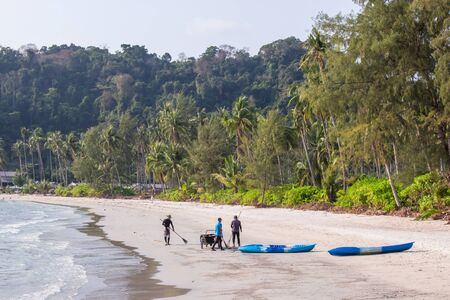 Beach cleaning staff group on the area ao prao at koh kood island, Trat Province Thailand.