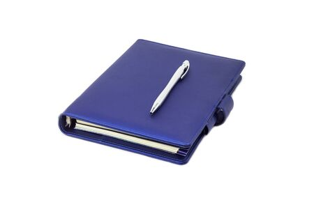Blue collar diary and pen placed on cover and white background. Zdjęcie Seryjne