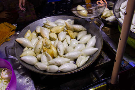 Frying fish meatballs are fried with hot oil on a pan stove. Thai street food easy and convenient. Standard-Bild