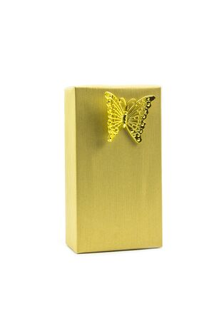 Gold gift box and butterfly isolated on white background.
