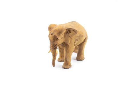 Elephant carved out of hardwood isolated on a white background. Thailand.