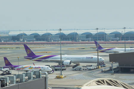 Bangkok, Thailand - March 10, 2020: Airplanes from Thai Airways (TG) are parked their hub at passenger gate, connect to gate inside Suvarnabhumi International Airport Samutprakan. Thailand. Editorial
