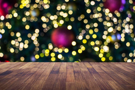 Wood table brown with blurred light bokeh christmas decoration background can be used for display or montage your products.