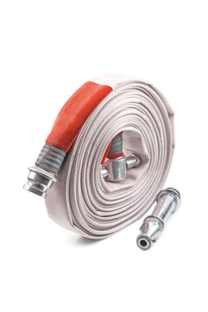 Red fire hose coil isolated on the white background. Standard-Bild