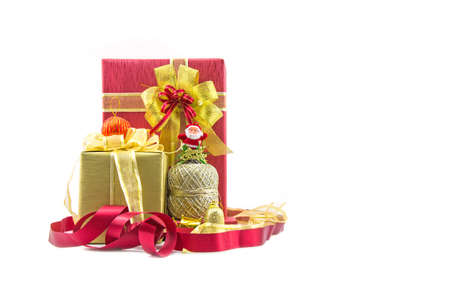 Christmas new year celebration decorations concept - Red and ribbon gold gifts box and decorating elements isolated on white background.