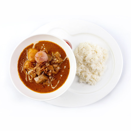 Thai Massaman Curry in a bowl and rice , Thai coconut milk curry Stock Photo