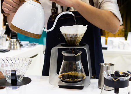 Barista is making coffee, coffee preparing with dripper