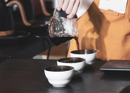 Tasting Coffee, Coffee tasting glasses in a coffee shop Imagens