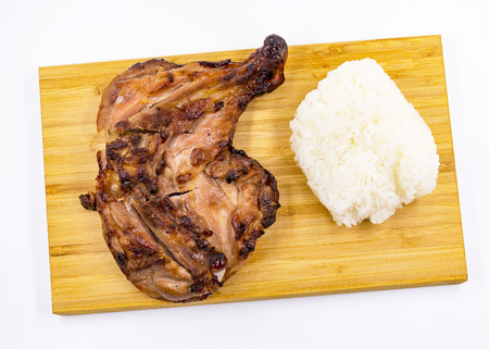 Grilled chicken drumstick  and Sticky rice on wooden background