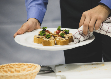 Decorating The Food In The Restaurant, Waiter is working on finishing a dish, diner waiter sandwiches