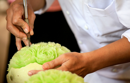 Thai fruit carving with hand, Vegetable and Fruit Carving Imagens