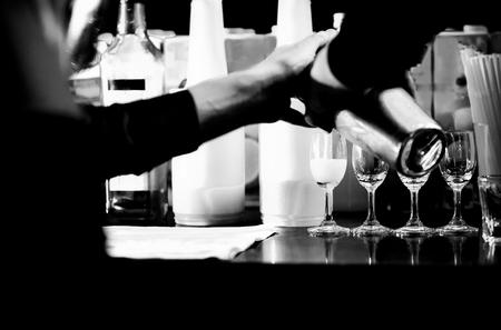 Bartender making alcohol cocktail at bar counter at nightclub, barman is making cocktail Reklamní fotografie