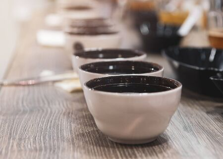 Tasting coffee in glass, Coffee cups on table for tasting