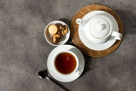 White porcelain tea cup and teapot, English tea on table, Afternoon Tea 写真素材