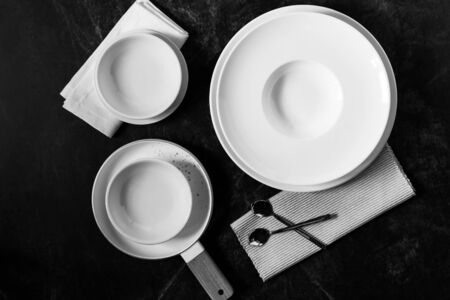 Dinner set on a dark background, Empty white plate with  Fork and Spoon