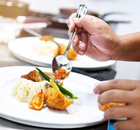 Chef preparing food in the kitchen Reklamní fotografie