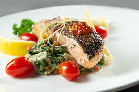 Tasty friend salmon, Grilled Salmon Steak with Spinach 免版税图像