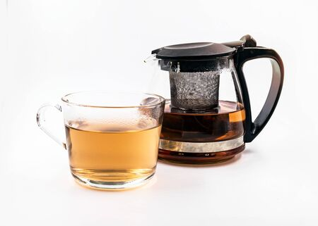 Teapot and cup with tea on white background Stockfoto