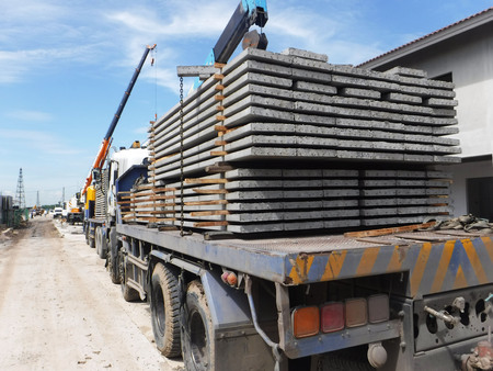 Precast plank concrete slabs on trucks at site construction