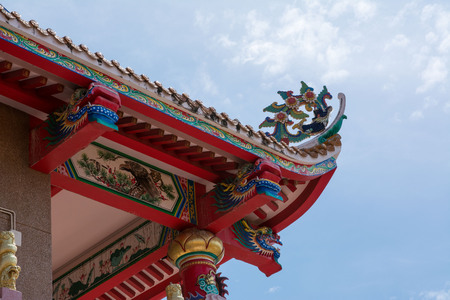 Chinese temple roof detail with blue sky