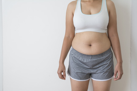 women fat with belly fat on white background Archivio Fotografico