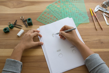 Jewelry designer is drawing sketch works Stock Photo