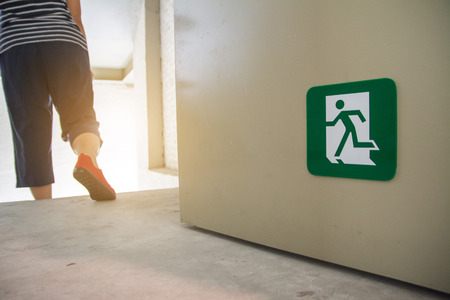 women walking to the emergency fire exit door Stock Photo