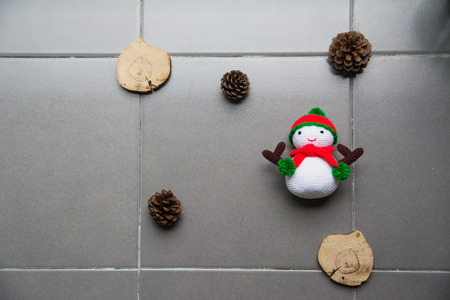 Christmas Concept  knitting snowman doll and pine cones