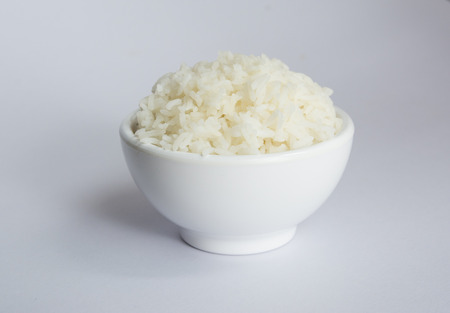 Jasmine rice in bowl on white background Stock Photo