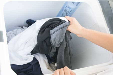 Prepare to wash your clothes with a washing machine.