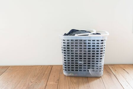 Laundry basket on floor and white background Stock fotó