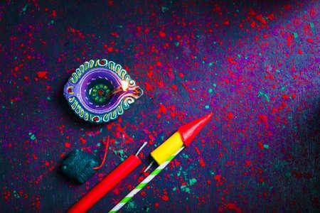 Diwali Diya with Fire Crackers over rangoli background Reklamní fotografie
