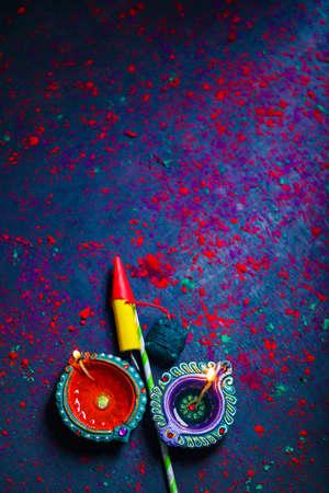 Diwali Diya with Fire Crackers over rangoli background