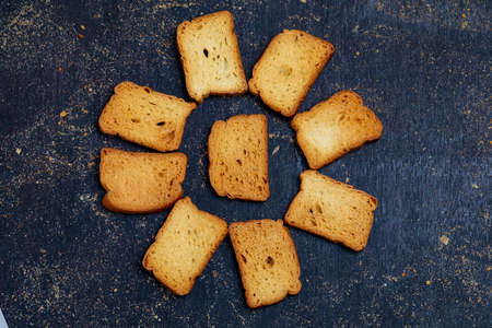 crispy rusk, cake rusk over Dark background Banco de Imagens