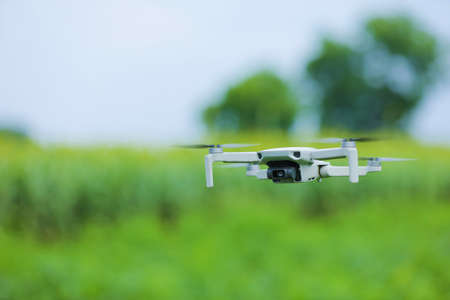 Close up view of flying drone over agriculture field