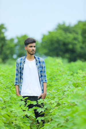 Young indian man showing expression over nature background