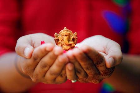 Lord ganesha festival. lord ganesha sclupture in hand Stock fotó