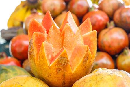 Fresh Papaya cut in flower shape and heap papaya bunch