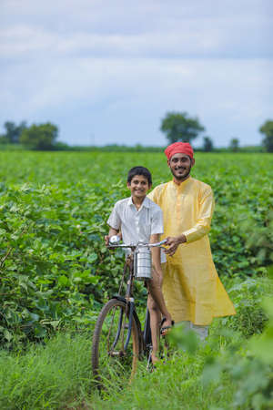 Indian farmer or labor with his child at cotton field