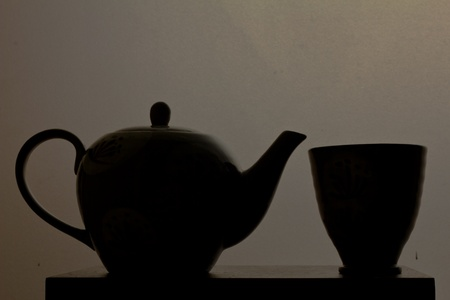 Teapot and teacup in silhouette photo