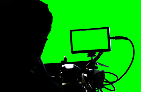 Movie camera with green screen.
